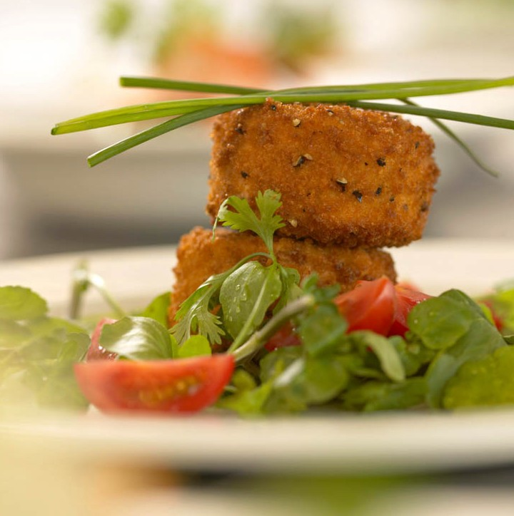 Plate of fish cakes garnished with chives
