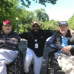 Community Life Assistant Steve with residents Tony and James pose for a picture while enjoying nature at its finest.