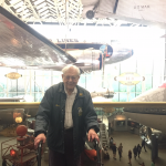 Bernie in front of the air plane at the Air and Space Museum.