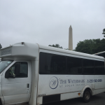 Watermark bus in front of Washington Monument.