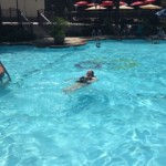 Jessica floating in the pool.