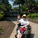 Junia waving and enjoying the trip at the zoo!