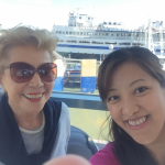 Marta and Saori selfie shot with a ferry behind!