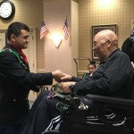 Willie receiving the honoring medal.