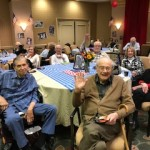 Residents enjoying the food and music during the party.