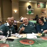 Harold, Sam and Gena cheering for the Eagles!