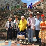 Happy residents on a wonderful tour of the Magic Gardens!