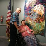 Drs. Martha and Elbert Magoon appreciating the intricate work on the jellyfish quilt.