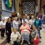 Our residents enjoying the colorful quilts!